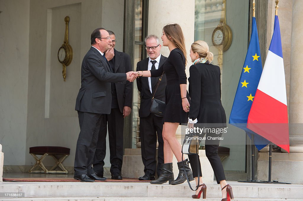 French president Francois Hollande welcomes Adele Exarchopoulos before a lunch at Elysee Palace on June 26, 2013 in Paris, France.