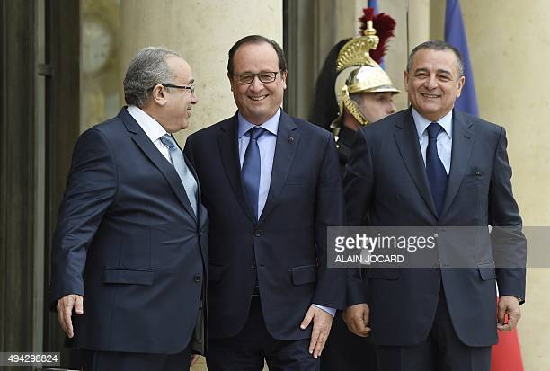 French President Francois Hollande welcomes Algerian Foreign Minister Ramtane Lamamra and Algerian Minister of Industry and Mining Abdeslam...
