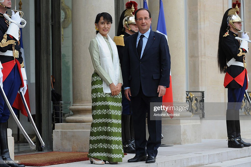 French President Francois Hollande welcomes Aung San Suu Kyi at Elysee Palace on June 26, 2012 in Paris, France. Burmese opposition leader Aung San Suu Kyi met with French President Francois Hollande during her five-country tour of Europe.