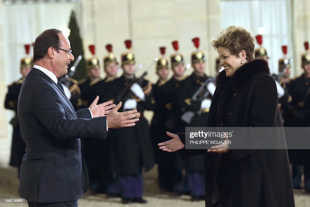 French President Francois Hollande (L) welcomes Brazil's President Dilma Rousseff for a state dinner at the Elysee Palace in Paris on December 11, 2012.