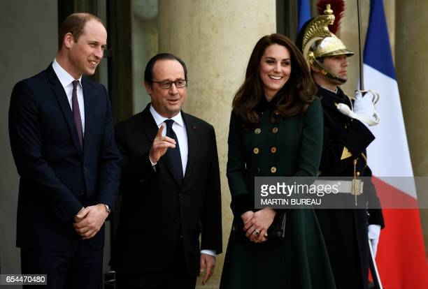 TOPSHOT French President Francois Hollande welcomes Britain's Prince William The Duke of Cambridge and his wife Kate the Duchess of Cambridge at the...