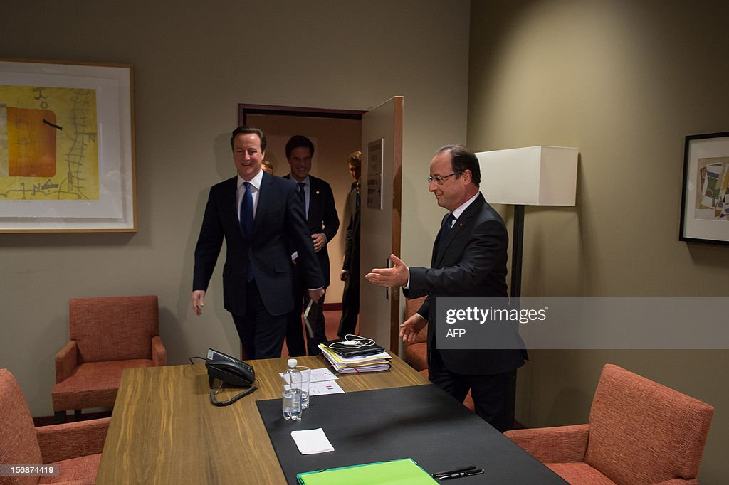 French President Francois Hollande (R) welcomes British Prime Minister David Cameron (L) and Dutch Prime Minister Mark Rutte prior to take part in a meeting at the EU Headquarters, on November 23, 2012 in Brussels, as part of a two-day European Union leaders summit called to agree a hotly-contested trillion-euro budget through 2020. European leaders voiced pessimism on reaching a deal on a trillion-euro EU bdget, as gruelling talks pushed into a second day with little prospect of bridging bitter divisions. POOL