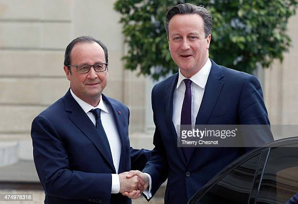 French President Francois Hollande welcomes British Prime Minister David Cameron prior a meeting at the Elysee Palace on May 28 2015 in Paris France...