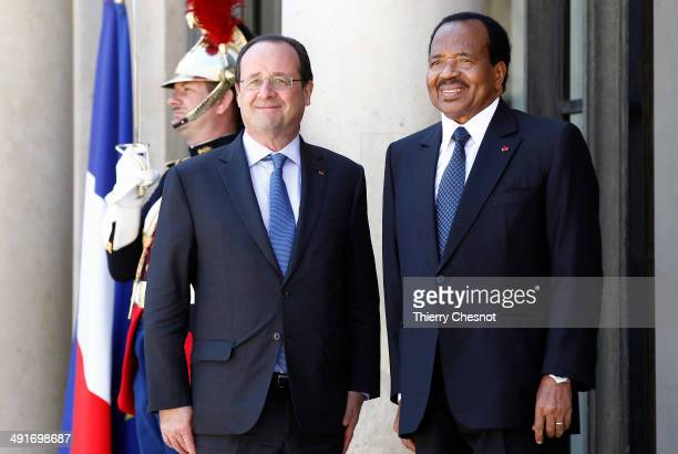 French President Francois Hollande welcomes Cameroon's President Paul Biya upon his arrival to an African security summit on May 17 at the Elysee...