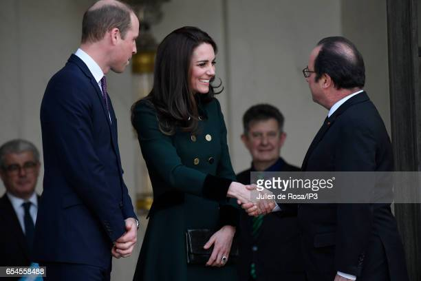 French President Francois Hollande welcomes Catherine Duchess of Cambridge and her husband Prince William Duke of Cambridge before their meeting at...