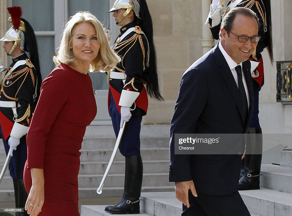 French president Francois Hollande (R) welcomes Danish Prime Minister <a gi-track='captionPersonalityLinkClicked' href=/galleries/search?phrase=Helle+Thorning-Schmidt&family=editorial&specificpeople=2485486 ng-click='$event.stopPropagation()'>Helle Thorning-Schmidt</a> at the Elysee presidential palace on August 30, 2014 in Paris, France. Francois Hollande host a meeting with European centre-left leaders to forge a common position ahead of the Brussels summit.