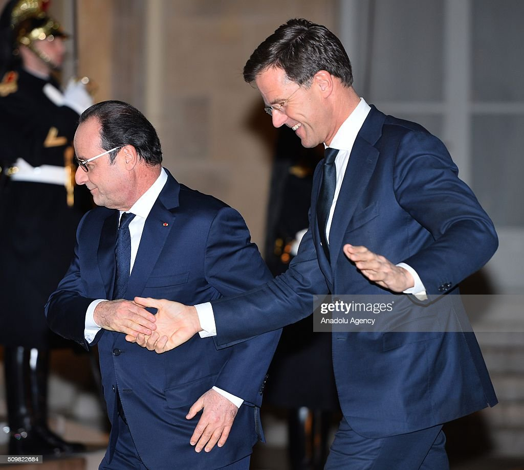 French President Francois Hollande (L) welcomes Dutch Prime Minister Mark Rutte (R) at the Elysee Palace in Paris, France on February 12, 2016.