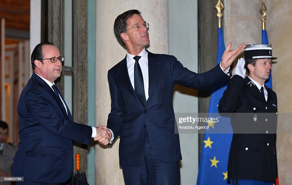 French President Francois Hollande (L) welcomes Dutch Prime Minister Mark Rutte (C) at the Elysee Palace in Paris, France on February 12, 2016.