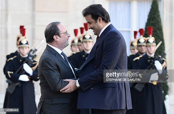 French President Francois Hollande welcomes Emir of Qatar Sheikh Tamim bin Hamad alThani upon his arrival on February 16 2016 at the Elysee...