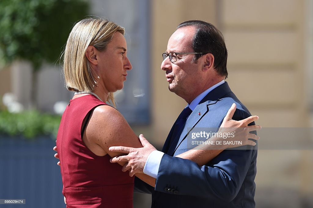 French president Francois Hollande welcomes European Union High Representative for Foreign Affairs and Security Policy Federica Mogherini outside the...
