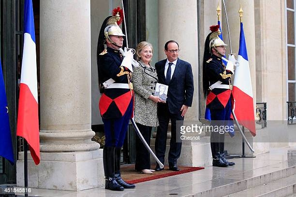 French President Francois Hollande welcomes former US Secretary of State and Senator Hillary Clinton prior a meeting at the Elysee Palace on July 8...