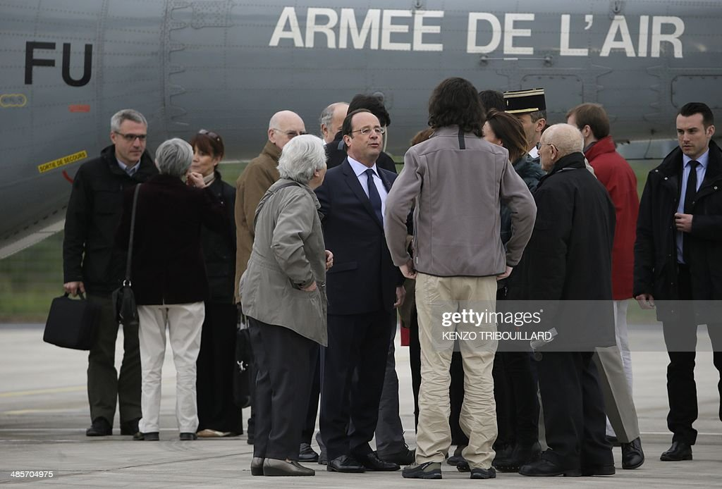 French President Francois Hollande welcomes four French journalists Edouard Elias Didier Francois Nicolas Henin and Pierre Torres taken hostage in...