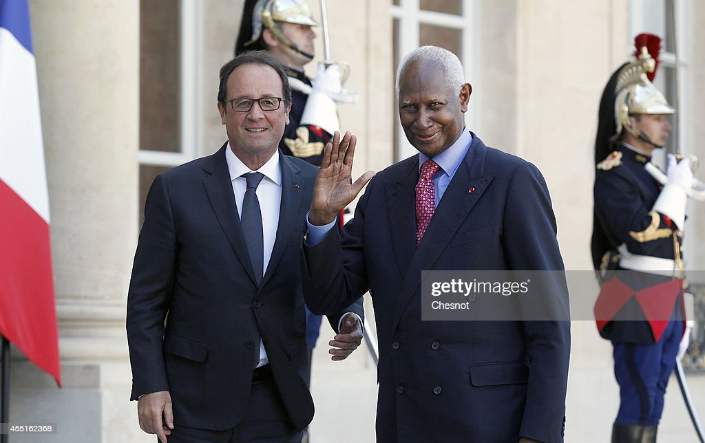 French President Francois Hollande welcomes General Secretary of the International Organisation of Francophonie and former Senegalese President <a gi-track='captionPersonalityLinkClicked' href=/galleries/search?phrase=Abdou+Diouf&family=editorial&specificpeople=216412 ng-click='$event.stopPropagation()'>Abdou Diouf</a> (R) prior their meeting at the Elysee Palace on September 10, 2014 in Paris, France.