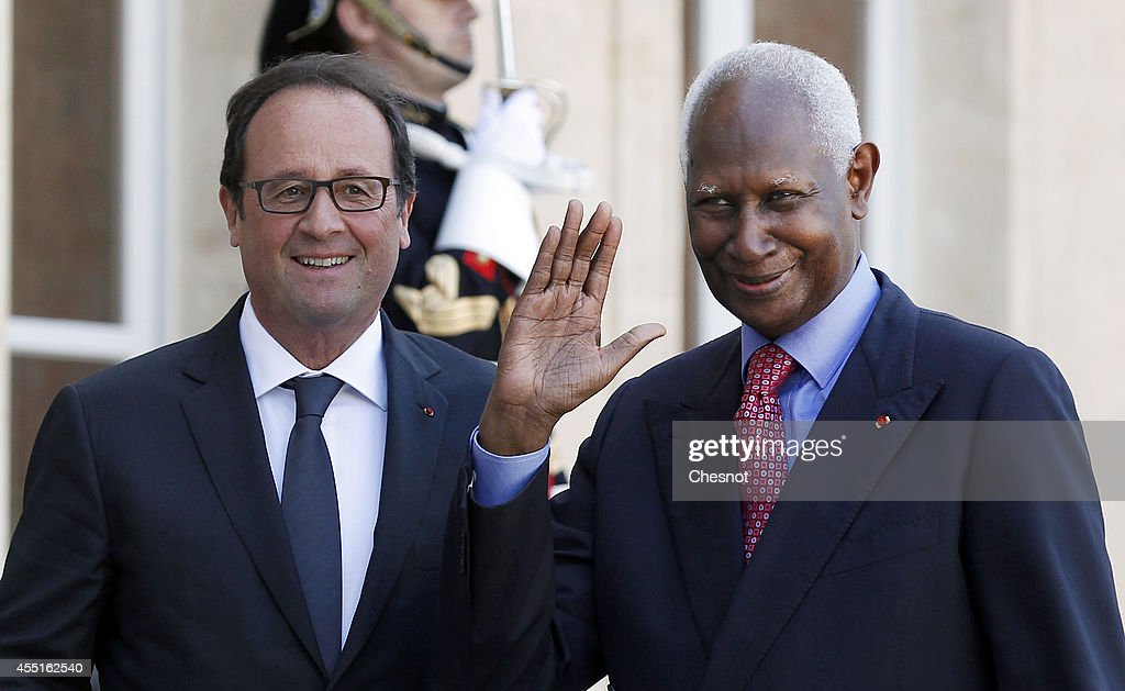 French President Francois Hollande welcomes General Secretary of the International Organisation of Francophonie and former Senegalese President Abdou Diouf (R) prior their meeting at the Elysee Palace on September 10, 2014 in Paris, France.