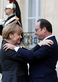 French President Francois Hollande welcomes German Chancellor Angela Merkel at the Elysee Palace before attending a Unity rally in tribute to the 17...