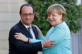 French President Francois Hollande welcomes German Chancellor Angela Merkel prior to a meeting at the Elysee Palace on July 06 2015 in Paris France...