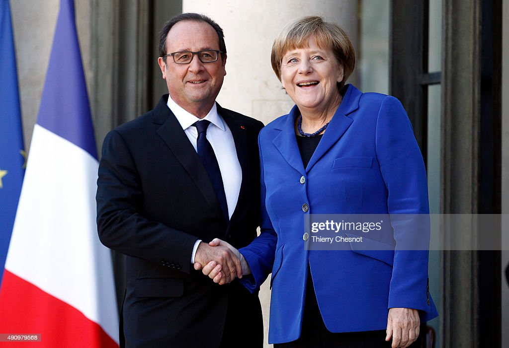 French President Francois Hollande welcomes German Chancellor Angela Merkel prior to their meeting at the Elysee Presidential Palace on October 02, 2015 in Paris, France. The leaders of France, Germany, Russia and Ukraine meet in Paris to consolidate a fragile peace in Ukraine, as a conflict that appears to be winding down is overshadowed by President Vladimir Putin's dramatic intervention in Syria's war.