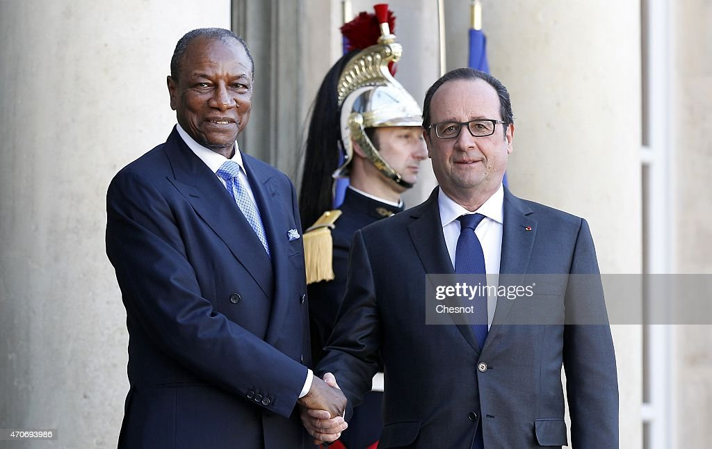 French President Francois Hollande (R) welcomes Guinean President Alpha Conde prior to a meeting at the Elysee Palace on April 22, 2015 in Paris, France.