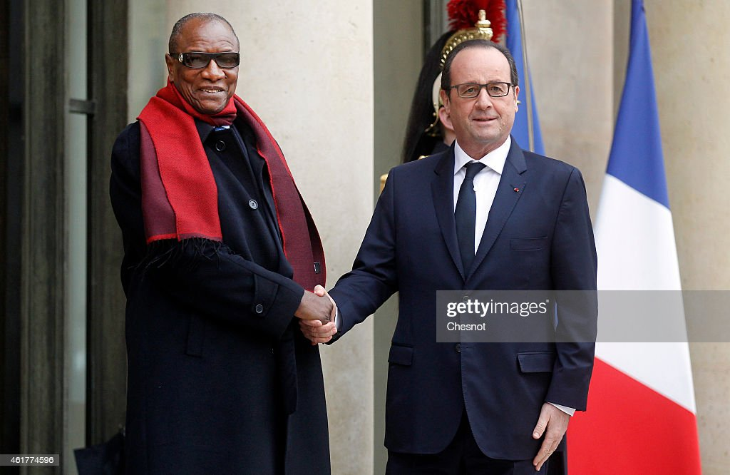 French president Francois Hollande (R) welcomes Guinea's president <a gi-track='captionPersonalityLinkClicked' href=/galleries/search?phrase=Alpha+Conde&family=editorial&specificpeople=2588606 ng-click='$event.stopPropagation()'>Alpha Conde</a> prior a meeting at the Elysee palace on January 19, 2015 in Paris, France. Guinea's president Omar <a gi-track='captionPersonalityLinkClicked' href=/galleries/search?phrase=Alpha+Conde&family=editorial&specificpeople=2588606 ng-click='$event.stopPropagation()'>Alpha Conde</a> is on a visit to Paris.