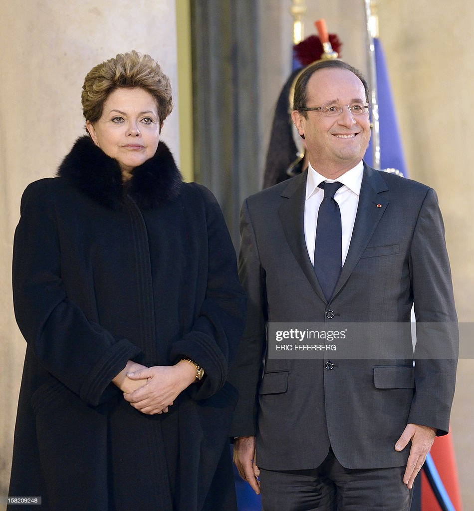 French President Francois Hollande (R) welcomes his Brazilian counterpart Dilma Rousseff on December 11, 2012 at the Elysee presidential palace in Paris. Brazilian President Dilma Rousseff Tuesday kicks off her first official visit to France, where a decision on whether she will choose Rafale fighter jets or opt for another aircraft is keenly awaited. During the two-day trip Rousseff will have talks with French counterpart Francois Hollande on the eurozone crisis -- on which she has criticized EU austerity measures -- bilateral trade and wider matters of global concern.