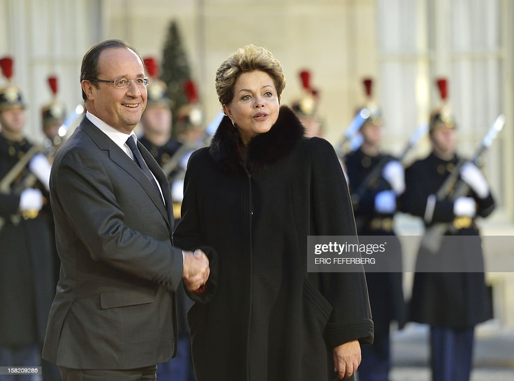 French President Francois Hollande (L) welcomes his Brazilian counterpart Dilma Rousseff on December 11, 2012 at the Elysee presidential palace in Paris. Brazilian President Dilma Rousseff Tuesday kicks off her first official visit to France, where a decision on whether she will choose Rafale fighter jets or opt for another aircraft is keenly awaited. During the two-day trip Rousseff will have talks with French counterpart Francois Hollande on the eurozone crisis -- on which she has criticized EU austerity measures -- bilateral trade and wider matters of global concern.