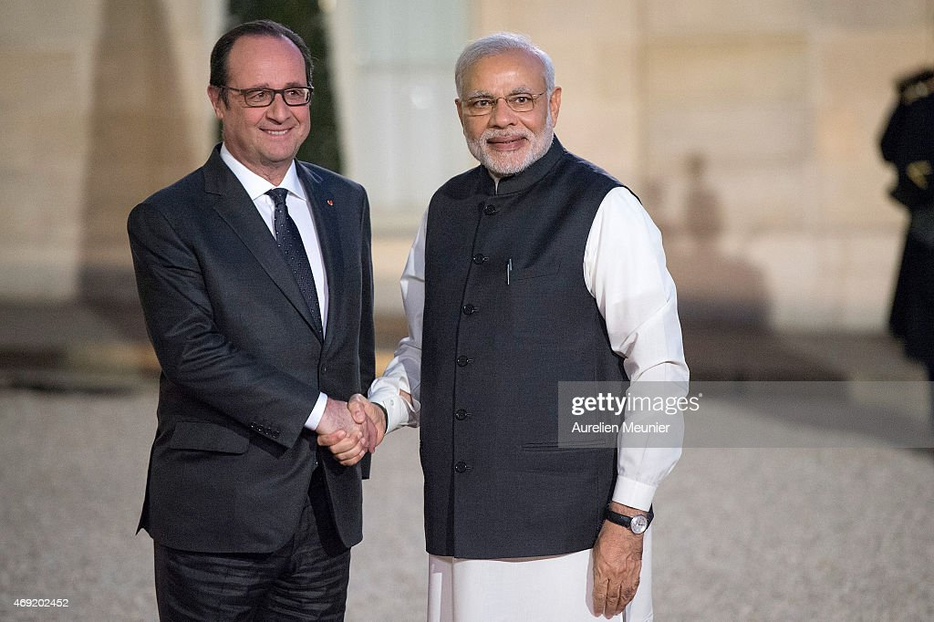 French President Francois Hollande (L) welcomes Indian Prime Minister Narendra Modi (R) to the Official Dinner in honor of the Prime Minister at Elysee Palace on April 10, 2015 in Paris, France. Narendra Modi announced that India ordered 36 Rafale Firefighter War Jets ready to fly from France for an estimated 4 Billion euros with terms outlining a speedy delivery date.