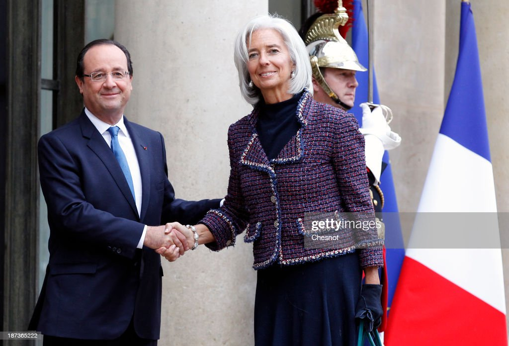 French President Francois Hollande (L) welcomes International Monetary Fund (IMF) Managing Director Christine Lagarde prior to a meeting at the Elysee Presidential Palace on November 8, 2013 in Paris, France. The rating of France's sovereign debt has been downgraded for the second time in two years, as ratings agency Standard and Poor's cut the nation's credit rating from AA+ to AA.