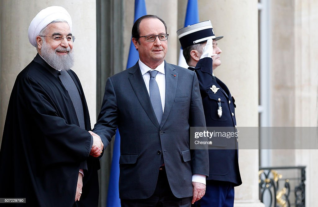 French President Francois Hollande (R) welcomes Iranian President Hassan Rouhani prior to attend a meeting at the Elysee Presidential Palace on January 28, 2016 in Paris, France. Hassan Rouhani is to make the first state visit to France by an Iranian president in nearly two decades following the lifting of sanctions against his country.