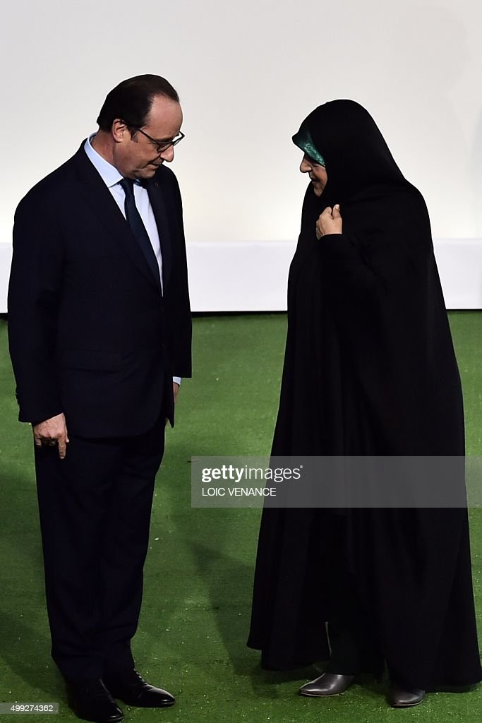 French President Francois Hollande (L) welcomes Iranian Vice-President Masoumeh Ebtekar upon her arrival, for the opening of the United Nations conference on climate change COP21, on November 30, 2015 at Le Bourget, on the outskirts of the French capital Paris. More than 150 world leaders are meeting under heightened security, for the 21st Session of the Conference of the Parties to the United Nations Framework Convention on Climate Change (COP21/CMP11), also known as Paris 2015 from November 30 to December 11.