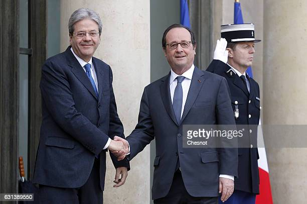French President Francois Hollande welcomes Italian Prime Minister Paolo Gentiloni before their meeting at the Elysee Presidential Palace on January...