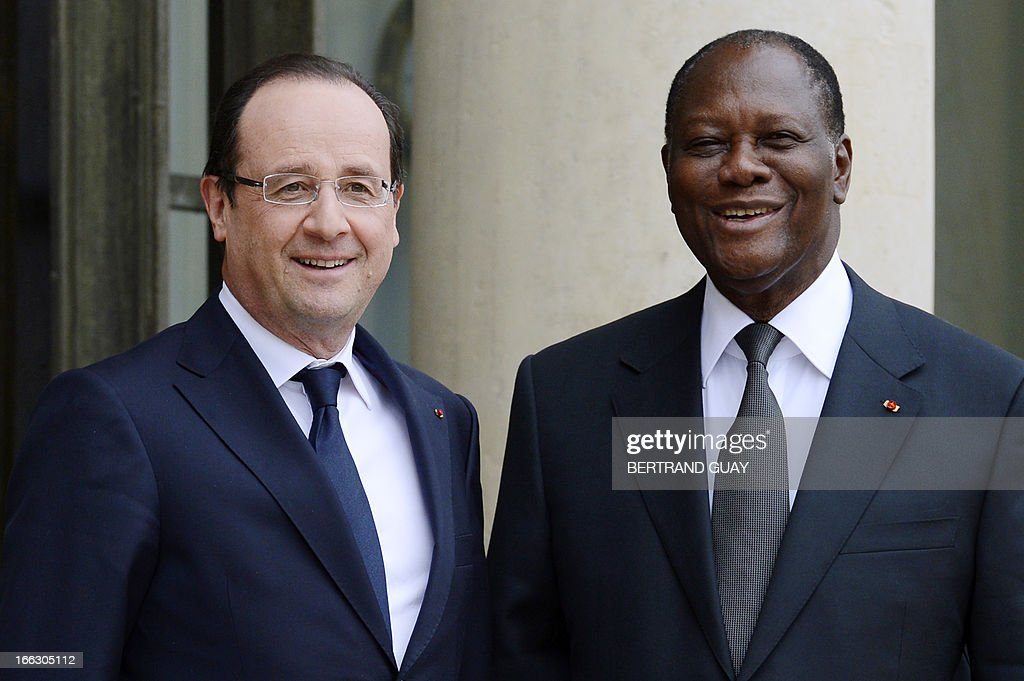 French President Francois Hollande (L) welcomes Ivorian President Alassane Ouattara prior to a meeting at the Elysee Palace in Paris, on April 11, 2013.