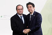 French president Francois Hollande welcomes Japanese Prime Minister Shinzo Abe as he arrives for the COP21 United Nations Climate Change Conference...