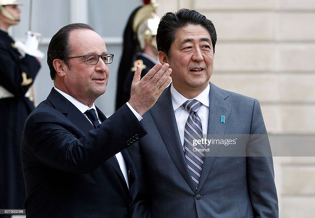 French President Francois Hollande welcomes Japanese Prime Minister Shinzo Abe prior to attend a meeting at the Elysee Presidential Palace on May 2, 2016 in Paris, France. Shinzo Abe began a week-long trip to several European countries and Russia prior to the G7 Summit to be held on May 26 and 27, 2016 in Japan.