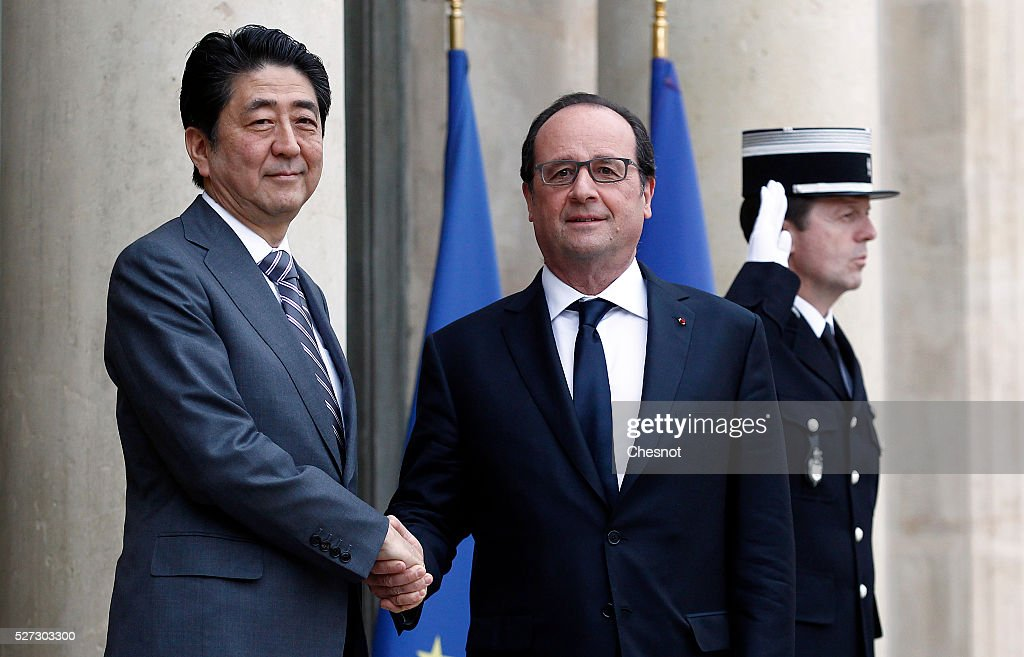 French President Francois Hollande welcomes Japanese Prime Minister <a gi-track='captionPersonalityLinkClicked' href=/galleries/search?phrase=Shinzo+Abe&family=editorial&specificpeople=559017 ng-click='$event.stopPropagation()'>Shinzo Abe</a> prior to attend a meeting at the Elysee Presidential Palace on May 2, 2016 in Paris, France. <a gi-track='captionPersonalityLinkClicked' href=/galleries/search?phrase=Shinzo+Abe&family=editorial&specificpeople=559017 ng-click='$event.stopPropagation()'>Shinzo Abe</a> began a week-long trip to several European countries and Russia prior to the G7 Summit to be held on May 26 and 27, 2016 in Japan.