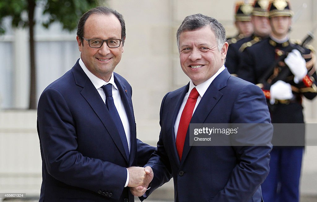 French President Francois Hollande (L) welcomes King Abdallah II of Jordan prior a meeting at Elysee Palace on September 17 in Paris, France.