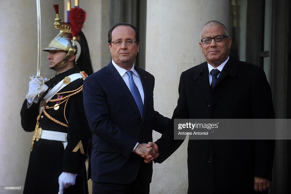 French President Francois Hollande (L) welcomes Libyan Prime Minister Ali Zeidan for the Peace And Safety In Africa Summit at Elysee Palace on December 6, 2013 in Paris, France.