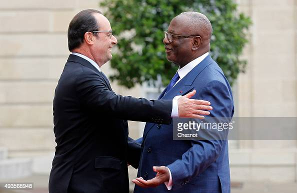 French President Francois Hollande welcomes Malian President Ibrahim Boubacar Keita at the Elysee Presidential Palace on October 21 2015 in Paris...