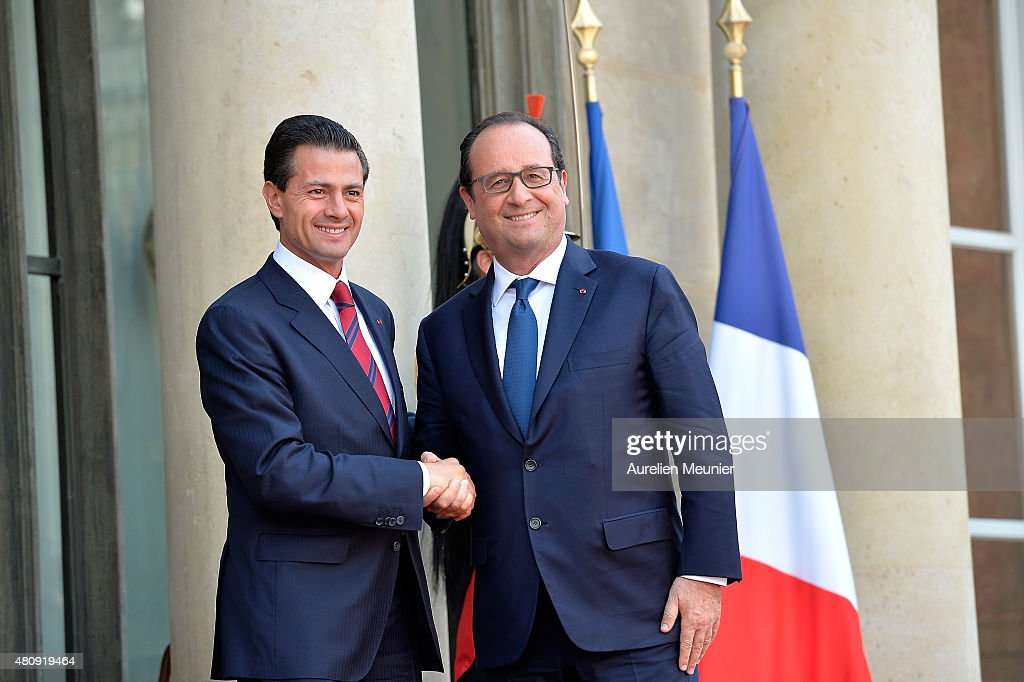 French President Francois Hollande (R) welcomes Mexican President <a gi-track='captionPersonalityLinkClicked' href=/galleries/search?phrase=Enrique+Pena+Nieto&family=editorial&specificpeople=5957985 ng-click='$event.stopPropagation()'>Enrique Pena Nieto</a> (L) for a strategical meeting at Elysee Palace on July 16, 2015 in Paris, France. They will talk about the universel abolition of the death penalty and their cooperation to maintain world peace.