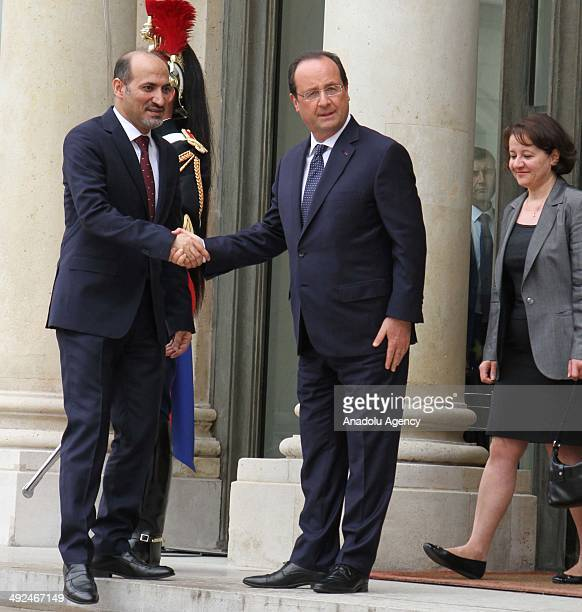 French President Francois Hollande welcomes National Coalition for Syrian Revolutionary and Opposition Forces President Ahmad AlJarba at the Elysee...
