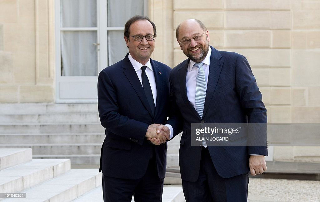 French president Francois Hollande (L) welcomes newly re-elected European Parliament president, German Social-Democrat Martin Schulz, before a meeting at the Elysee presidential palace on July 3, 2014 in Paris.