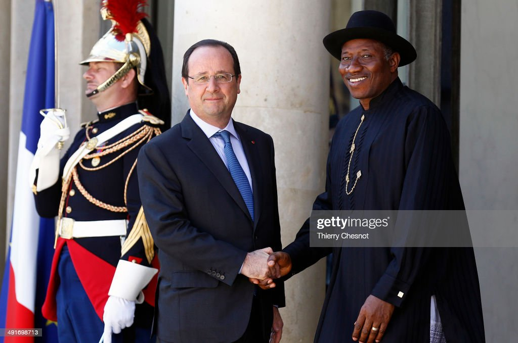 French President Francois Hollande (R) welcomes Nigeria's President <a gi-track='captionPersonalityLinkClicked' href=/galleries/search?phrase=Goodluck+Jonathan&family=editorial&specificpeople=4124968 ng-click='$event.stopPropagation()'>Goodluck Jonathan</a> (L), upon his arrival to an African security summit on May 17, 2014, at the Elysee palace in Paris, France. The African security summit is being held to discuss the Boko Haram threat to regional stability.