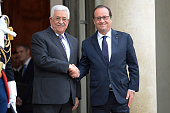 French President Francois Hollande welcomes Palestinian President Mahmoud Abbas before a meeting at Elysee Palace on September 22 2015 in Paris...