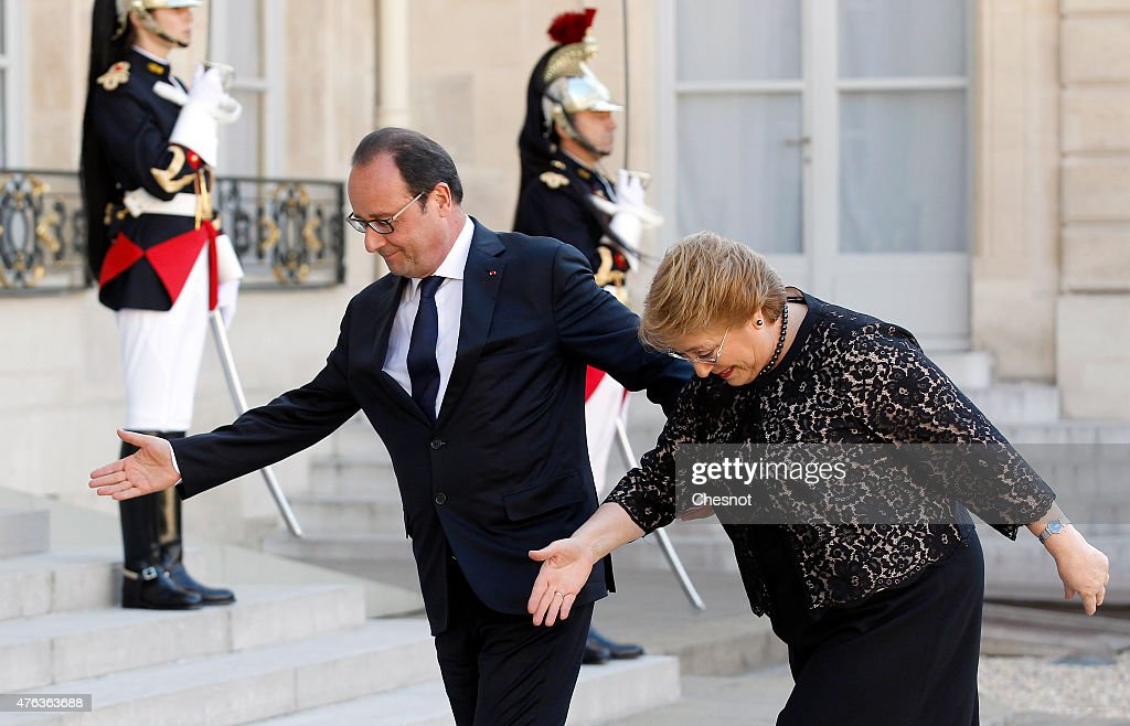 French President Francois Hollande welcomes President of Chile <a gi-track='captionPersonalityLinkClicked' href=/galleries/search?phrase=Michelle+Bachelet&family=editorial&specificpeople=547978 ng-click='$event.stopPropagation()'>Michelle Bachelet</a> prior to a meeting at the Elysee Palace on June 08, 2015, in Paris, France. <a gi-track='captionPersonalityLinkClicked' href=/galleries/search?phrase=Michelle+Bachelet&family=editorial&specificpeople=547978 ng-click='$event.stopPropagation()'>Michelle Bachelet</a> met with Francois Hollande to discuss economic issues, academic cooperation and preparation for the climate conference.