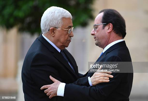 French President Francois Hollande welcomes President of the Palestinian Authority Mahmoud Abbas upon his arrival on July 21 2016 at the Elysee...
