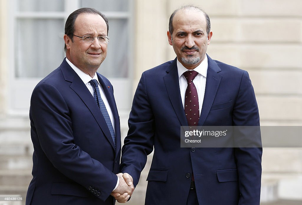 French President Francois Hollande welcomes President of the Syrian National Coalition, <a gi-track='captionPersonalityLinkClicked' href=/galleries/search?phrase=Ahmad+Jarba&family=editorial&specificpeople=11168559 ng-click='$event.stopPropagation()'>Ahmad Jarba</a> on May 20, 2014, at the Elysee Presidential palace in Paris, France.