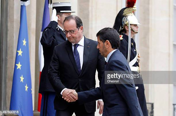 French President Francois Hollande welcomes Qatari Prime Minister Abdullah bin Nasser bin Khalifa Al Thani prior to a meeting at the Elysee...