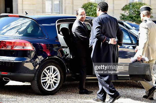 French President Francois Hollande welcomes Queen Elizabeth II at the Elysee Presidential Palace as part of a bilateral meeting during an Official...