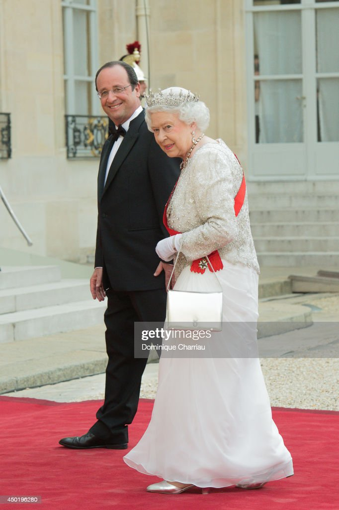 French President Francois Hollande welcomes Queen <a gi-track='captionPersonalityLinkClicked' href=/galleries/search?phrase=Elizabeth+II&family=editorial&specificpeople=67226 ng-click='$event.stopPropagation()'>Elizabeth II</a> at the Elysee Palace for a State dinner in honor of Queen <a gi-track='captionPersonalityLinkClicked' href=/galleries/search?phrase=Elizabeth+II&family=editorial&specificpeople=67226 ng-click='$event.stopPropagation()'>Elizabeth II</a>, hosted by French President Francois Hollande as part of a three days State visit of Queen <a gi-track='captionPersonalityLinkClicked' href=/galleries/search?phrase=Elizabeth+II&family=editorial&specificpeople=67226 ng-click='$event.stopPropagation()'>Elizabeth II</a> after the 70th Anniversary Of The D-Day on June 6, 2014 in Paris, France.