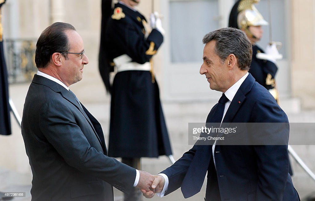 French President Francois Hollande welcomes rightwing Les Republicains party's President and former French president Nicolas Sarkozy at the...