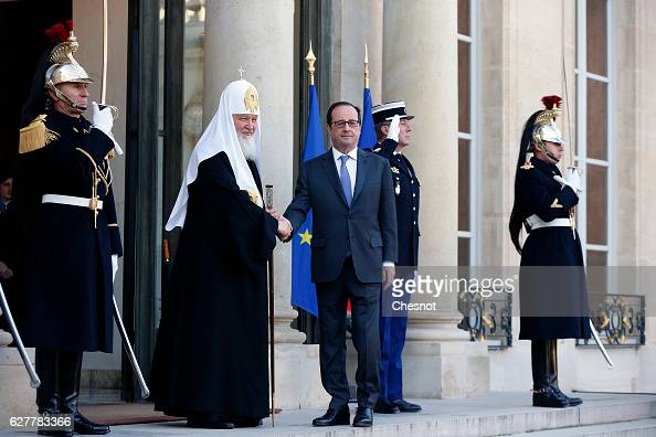 French President Francois Hollande welcomes Russian Patriarch Kirill prior to a meeting at the Elysee Presidential Palace on December 5 2016 in Paris...